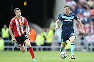 Middlesbrough midfielder Stewart Downing (19)  tries to get away  during the Premier League match between Sunderland and Middlesbrough at the Stadium Of Light, Sunderland, England on 21 August 2016. Photo by Simon Davies.