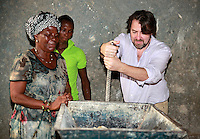Today marks the 25th annive Jonathan Ross visits the African Women's Development Fund in Accra, Ghana. Jonathan Ross trying his hands on the milling machine assisted by Comfort Zormelo. Jonathan Ross is in Ghana with Comic Relief to mark the 25th anniversary of Red Nose Day. Thirteen Red Nose Days later it has raised over £600million and over the last 25 years that money will have helped 50 million people across Africa, the world's poorest countries and here in the UK. Keep up the good work. rednoseday.com ©Christian Thompson