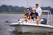 A teenage boy and his father bond while on a fishing trip off the coast of Kiawah Island, South Carolina