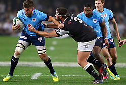 Hanro Liebenberg of the Bulls is tackled by Thomas du Toit during the Currie Cup match between the The Sharks and The Blue Bulls held at King's Park, Durban, South Africa on the 27th August 2016<br /> <br /> Photo by:   Anesh Debiky / Real Time Images