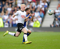 Derby County's Will Hughes jostles for the ball with Ipswich Town's Paul Anderson - Photo mandatory by-line: Dougie Allward/JMP - Mobile: 07966 386802 30/08/2014 - SPORT - FOOTBALL - Derby - iPro Stadium - Derby County v Ipswich Town - Sky Bet Championship