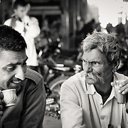 Two men drinking chai at village market in Rajasthan