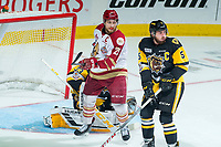 REGINA, SK - MAY 22: Jeffrey Truchon-Viel #25 of Acadie-Bathurst Titan looks for the pass in front of the net of Kaden Fulcher #33 while checked by Justin Lemcke #5 of Hamilton Bulldogs  at Brandt Centre - Evraz Place on May 22, 2018 in Regina, Canada. (Photo by Marissa Baecker/Getty Images)