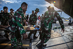 October 2, 2018 - Palu, Central Sulawesi, Indonesia - Indonesian military carrying a survivor who will evacuated for medical care in Palu. The Indonesian government on October 2 said the death toll from a devastating quake-tsunami on the island of Sulawesi had risen to 1,234 people confirmed dead. A magnitude 7.5 earthquake and tsunami September 28, devastated the coastline on the island of Sulawesi, causing thousands of homes to collapse, along with hospitals, hotels and shopping centers. (Credit Image: © Ivan Damanik/ZUMA Wire)