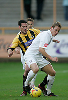 Photo: Marc Atkins.<br />Boston United v Hereford United. Coca Cola League 2. 25/11/2006. Neil Mackenzie of Hereford tussles with Mark Greaves of Boston for the ball.