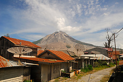 July 4, 2017 - North Sumatera, Indonesia - The increased volume of lava dome that reaches one million eight hundred cubic meters, said volcanologist, through radio communications, do not dampen the activities of the people around sinabung, such as farming, harvesting their crops, picking up objects that are still left behind, or just take a picture while walking around near mount Sinabung. (Credit Image: © Sabirin Manurung/Pacific Press via ZUMA Wire)