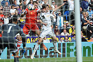 Southampton's Rickie Lambert © forces the ball over the line to  score his sides 1st goal. Barclays Premier league match, Swansea city v Southampton at the Liberty stadium in Swansea, South Wales on Saturday 3rd May 2014.<br /> pic by Phil Rees, Andrew Orchard sports photography.