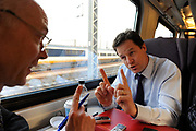 Nick Clegg MP, Leader of the Liberal Democrats and Deputy Prime Minister in the coalition government being interviewed on a train by the BBCs Nick Robinson on 25 March 2011 in the United Kingdom.