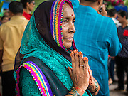 31 AUGUST 2014 - SARIKA, NAKHON NAYOK, THAILAND: A woman prays at the Ganesh festival at Shri Utthayan Ganesha Temple in Sarika, Nakhon Nayok. Ganesh Chaturthi, also known as Vinayaka Chaturthi, is a Hindu festival dedicated to Lord Ganesh. It is a 10-day festival marking the birthday of Ganesh, who is widely worshiped for his auspicious beginnings. Ganesh is the patron of arts and sciences, the deity of intellect and wisdom -- identified by his elephant head. The holiday is celebrated for 10 days, in 2014, most Hindu temples will submerge their Ganesh shrines and deities on September 7. Wat Utthaya Ganesh in Nakhon Nayok province, is a Buddhist temple that venerates Ganesh, who is popular with Thai Buddhists. The temple draws both Buddhists and Hindus and celebrates the Ganesh holiday a week ahead of most other places.    PHOTO BY JACK KURTZ