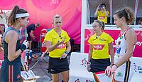 ANTWERPEN -  Eva de Goede (Ned) met Janne Müller-Wieland (Ger) en de umpires Laurine Delforge (BEL) en Sarah Wilson (SCO)  voor de finale  dames  Nederland-Duitsland  (2-0) bij het Europees kampioenschap hockey.   Nederland prolongeert de titel. COPYRIGHT  KOEN SUYK