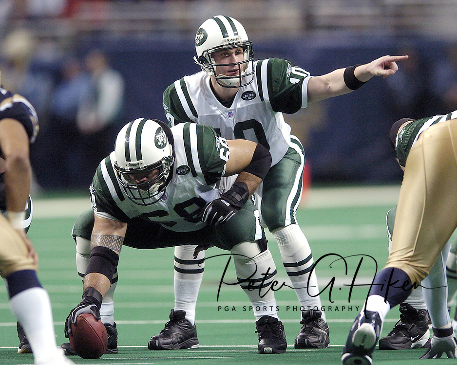 New York Jets quarterback Chad Pennington (10) points out a shift in the Rams defense, as he gets ready to take the snap from center Kevin Mawae (68), during the second half in St. Louis, Missouri.  The Jets lost in overtime to St. Louis 32-29 on January 2, 2005.