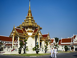 November 3, 2018 - Bangkok, Bangkok, Thailand - Participants in the funeral of Vichai Srivaddhanaprabha walk past the crematorium at Wat Debsirin on the first day of funeral rites for Vichai. Vichai was the owner of King Power, a Thai duty free conglomerate, and the Leicester City Club, a British Premier League football (soccer) team. He died in a helicopter crash at the King Power stadium in Leicester after a match on October 27. Vichai was Thailand's 5th richest man. The funeral is expected to last one week. (Credit Image: © Sean Edison/ZUMA Wire)