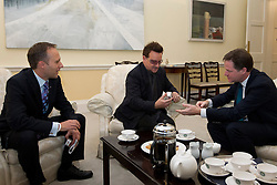 © Licensed to London News Pictures. 11/10/2012. LONDON, UK. Business minster Joe Swinson (L) U2 singer Bono (C) and the British Deputy Prime Minister Nick Clegg are seen in Whitehall, London, today (11/10/12) as they meet to discuss international development issues. Photo credit: Matt Cetti-Roberts/LNP