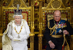 File photo dated 04/06/2014 of Queen Elizabeth II siting alongside the Duke of Edinburgh as she delivers her speech in the House of Lords during the State Opening of Parliament at the Palace of Westminster in London. Prince Philip's final public engagement takes place on Wednesday, before he retires at the age of 96.