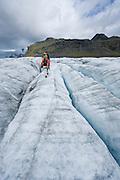 Hiking on Virkisjökull glacier in the south of Iceland.