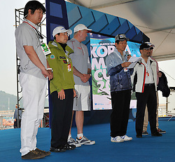 Kim Dong Young, CEO Sail Korea, Kwang-Hoe Kim, Gyeonggi Provence Tourism Minister, Peter Gilmour, Yanmar Racing, WMRT Executive Chairman, Patrick Lim and Kjell Ortengren, President of Scania Korea Ltd watch Kim Moon Soo, Governor of Gyeonggi Province, welcoming the crews for the Pro-Am race . Photo:Chris Davies/WMRT