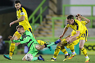 Forest Green Rovers George Williams(11) is brought down by Oxford United's Sam Long(23) during the The FA Cup 1st round replay match between Forest Green Rovers and Oxford United at the New Lawn, Forest Green, United Kingdom on 20 November 2018.
