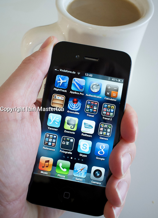 Detail of home screen with many apps on an iPhone 4g smart phone