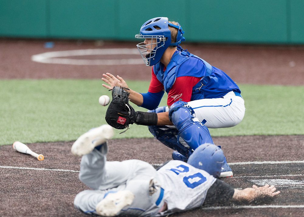 Post 307's Peyton Garbers beats the throw to Creighton Prep catcher Owen Richter. Post 1 Omaha, Nebraska, played Post 307 Renner, South Dakota, in a legion baseball game at Creighton Prep on Wednesday, June 20, 2018, in Omaha, Nebraska.