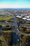 Nederland, Gelderland, Hoevelaken, 01-20-2011.Rijskweg A28 en de A1,.Bij knooppunt Hoevelaken is een file aan het ontstaan.  Bedrijventerrein De Hoef (rechtsboven)..The beginning of traffic jam at junction Hoevelaken..luchtfoto (toeslag), aerial photo (additional fee required) .copyright foto/photo Siebe Swart