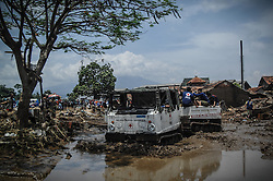 September 23, 2016 - Garut, Indonesia - Volunteers and Indonesian Red Cross open the road Kampung Bojong Sudika, Cimacan, in Garut district, West Java province on September 23, 2016, two days after a series of landslides and flash floods hit several areas. The death toll from devastating floods and landslides in Indonesia has risen to 26, an official said, with hopes fading for 19 others still missing. (Credit Image: © Dasril Roszandi/NurPhoto via ZUMA Press)
