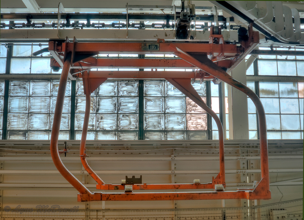 Clam shell body carrier in upper level of main assembly plant with window designs Chrysler Newark main assembly plant