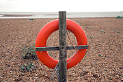 Red life saving ring Shingle Street beach, Suffolk, England