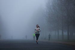 © Licensed to London News Pictures. 07/12/2020. London, UK. A runner in dense fog in Finsbury Park, north London. Freezing cold and foggy weather is forecast across many parts of the UK. Photo credit: Dinendra Haria/LNP