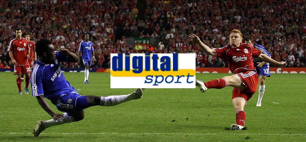 Photo: Paul Thomas.<br /> Liverpool v Chelsea. UEFA Champions League. Semi Final, 2nd Leg. 01/05/2007.<br /> <br /> John Arne Riise of Liverpool shoots past Michael Essien during extra time.