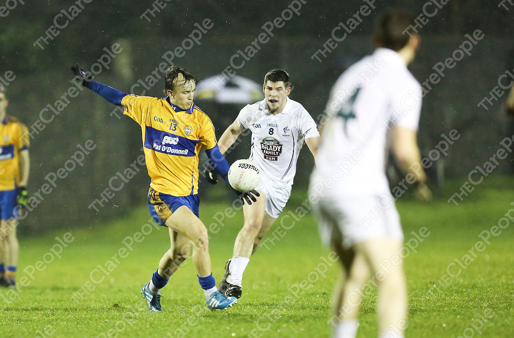 Clare's Martin O'Leary &  Kildare's Gary Savage in action during their Hasting Cup U21 Football Game played in Limerick.<br /> Picture Credit Brian Gavin Press 22