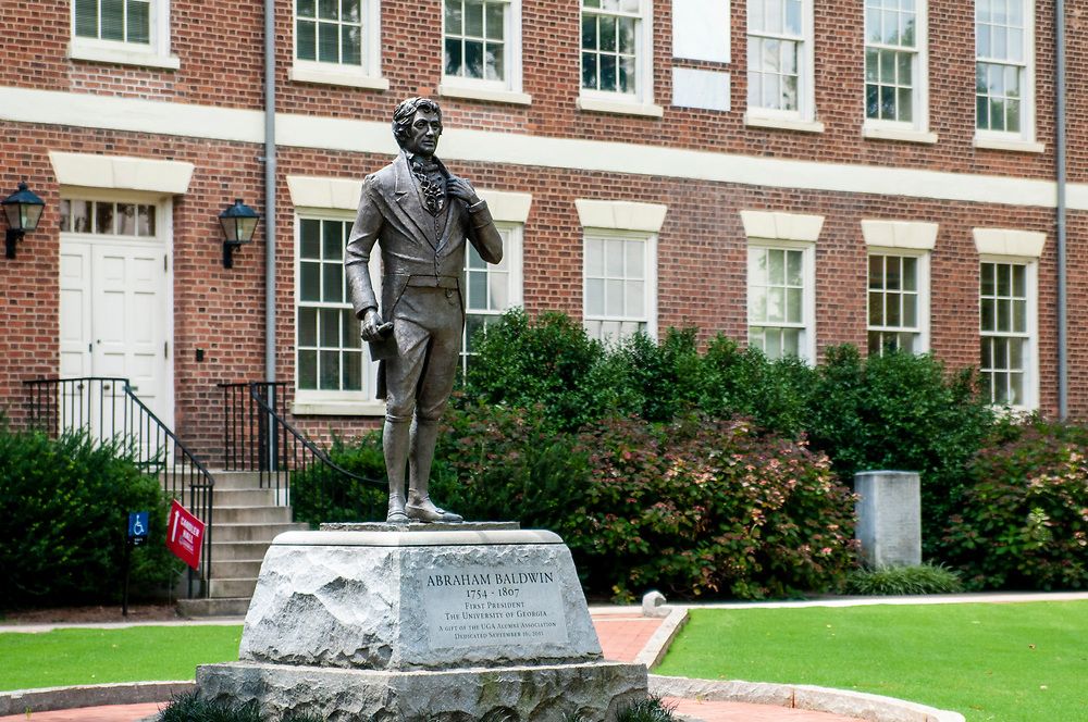 Statue dedicated to Abraham Baldwin, the first president of UGA, in front of Old College, the oldest building on campus, at the University of Georgia in Athens, Georgia on Thursday, July 15, 2021. Copyright 2021 Jason Barnette