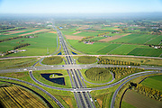 Nederland, Gelderland, Deil, 24-10-2013; knooppunt Deil, kruising A15 (vlnr) en A2, richting Utrecht.. Betuweroute vlnr parallel aan A15.<br /> Deil junction, main motorway A15 Rotterdam Harbour - Germany crossing A2 to the South. <br /> luchtfoto (toeslag op standaard tarieven);<br /> aerial photo (additional fee required);<br /> copyright foto/photo Siebe Swart.