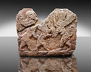 Picture of a Neo-Hittite orthostat describing the legend of Gilgamesh from Karkamis, Turkey. Ankara Museum of Anatolian Civilizations. Mythological Scene of 2 Spinxes standing on their back legs either side of a winged horse which is also standing on its rear legs. 1