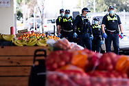 MELBOURNE, VIC - SEPTEMBER 20: Victoria Police officers are seen patrolling outside of Footscray Market during the Freedom protest on September 20, 2020 in Melbourne, Australia. Freedom protests are being held in Melbourne every Saturday and Sunday in response to the governments COVID-19 restrictions and continuing removal of liberties despite new cases being on the decline. Victoria recorded a further 14 new cases overnight along with 5 deaths. (Photo by Mikko Robles/Speed Media)