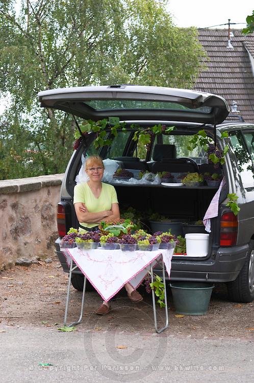 woman selling grapes riquewihr alsace france