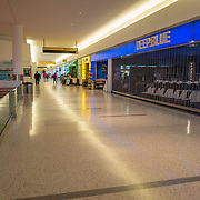 The JetBlue terminal at JFK Airport remains sparse during the Phase 4 reopening on Wednesday August 5, 2020 in New York, New York. Mayor de Blasio is asking travelers from 34 states and Puerto Rico, where COVID-19 infection rates are high, to quarantine for 14 days after arriving in the city.  (Alex Menendez via AP)