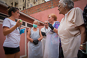 08/09/2015 - Lisbon, Portugal: Lara Seixo Rodrigues, 36, explains to the participants of the Lata 65 workshop on how to use a paint can before they paint the wall. Lata 65 was project created by Lara Seixo Rodrigues and is a creative workshop teaching street art to senior citizens. (Eduardo Leal)