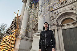 "© Licensed to London News Pictures. 30/11/2018. LONDON, UK. Turner Prize nominated artist Monster Chetwynd poses in front of her new Tate Britain Winter Commission.  The artist, formerly known as ""Marvin Gaye"" and ""Spartacus"", has transformed Tate Britain's iconic Neo-Classical façade to mark the winter season with a new piece inspired by the winter solstice, involving a dazzling light display and elements of sculpture.  Winter Commission 2018: Monster Chetwynd will be switched on daily from 1st December 2018 - 28 February 2019.  Photo credit: Stephen Chung/LNP"