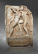 Roman Sebasteion relief sculpture of Achilles and a dying Amazon, Aphrodisias Museum, Aphrodisias, Turkey. Against a grey background.  <br /> <br /> Achilles supports the dying Amazon queen Penthesilea whom he has mortally wounded. Her double headed axe slips from her hands. The queen had come to fight against the Greeks in the Trojan war and Achilles fell in love with her. .<br /> <br /> If you prefer to buy from our ALAMY STOCK LIBRARY page at https://www.alamy.com/portfolio/paul-williams-funkystock/greco-roman-sculptures.html . Type -    Aphrodisias     - into LOWER SEARCH WITHIN GALLERY box - Refine search by adding a subject, place, background colour, museum etc.<br /> <br /> Visit our ROMAN WORLD PHOTO COLLECTIONS for more photos to download or buy as wall art prints https://funkystock.photoshelter.com/gallery-collection/The-Romans-Art-Artefacts-Antiquities-Historic-Sites-Pictures-Images/C0000r2uLJJo9_s0