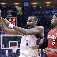 12 June 2012: Oklahoma City Thunder center Kendrick Perkins (5) passes the ball during the Oklahoma City Thunder 105-94 victory over the Miami Heat, in Game 1 of the 2012 NBA Finals, at the Chesapeake Energy Arena, Oklahoma City, Oklahoma, USA.