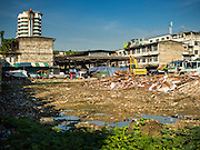 29 SEPTEMBER 2015 - BANGKOK, THAILAND:   Land being cleared for redevelopment with Bang Chak Market in the background. The Bang Chak Market serves the community around Sois 91-97 on Sukhumvit Road in the Bangkok suburbs. About half of the market has been torn down, vendors in the remaining part of the market said they expect to be evicted by the end of the year. The old market, and many of the small working class shophouses and apartments near the market are being being torn down. People who live in the area said condominiums are being built on the land.       PHOTO BY JACK KURTZ