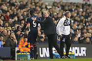 Steve McClaren, the Newcastle United gives a pat on the back to Papiss Demba Cisse of Newcastle United as he is replaced. Barclays Premier league match, Tottenham Hotspur v Newcastle Utd at White Hart Lane in London on Sunday 13th December 2015.<br /> pic by John Patrick Fletcher, Andrew Orchard sports photography.