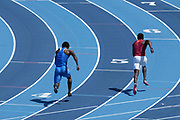 Davonte Burnett of UCLA (left) and Nicholas Ramey of Southern California run in the 200m during a dual meet at Drake Stadium, Sunday, May 2, 2021, in Los Angeles. (Kirby Lee via Image of Sport)