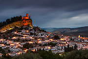 Spanish castle on a hill above a village