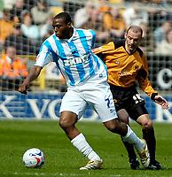 Photo: Ed Godden.<br />Wolverhampton Wanderers v Brighton & Hove Albion. Coca Cola Championship. 22/04/2006. Gifton Noel-Williams (L) and Wolves player, Colin Cameron.