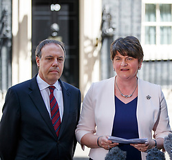 © Licensed to London News Pictures. 26/06/2017. London, UK. The DUP leader ARLENE FOSTER and DUP deputy leader NIGEL DODDS make a statement after meeting with Prime Minister Theresa May in Downing Street and reaching a final deal to form a propped up minority government with Conservatives on Monday, 26 June 2017. Photo credit: Tolga Akmen/LNP
