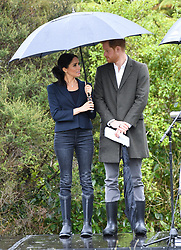 Prince Harry Duke of Sussex and Meghan Duchess of Sussex take part in the dedication of the Carol Whaley Native Bush to the Queen's Commonwealth Canopy. They also planted two trees and took part in a Welly Wanging contest which Team Duchess of Sussex won at Redvale, North Shore,<br />New Zealand. Photo credit should read: Doug Peters/EMPICS