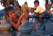 Children playing on the waterfront of the Tonle Sap in Phnom Penh