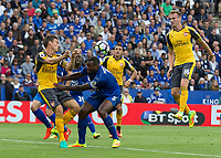 Football - 2016/2017 Premier League - Leicester Ciity V Arsenal. <br /> <br /> Wes Morgan of Leicester City seems to push Laurent Koscielny of Arsenal away from an incoming cross at The King Power Stadium.<br /> <br /> COLORSPORT/DANIEL BEARHAM