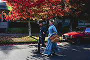 Sarah and Gabriel Chrisman walk to the small market down the street from their house in Port Townsend to pick up food for dinner. The couple began wearing Victorian-era clothing and adopted a period lifestyle six years ago.